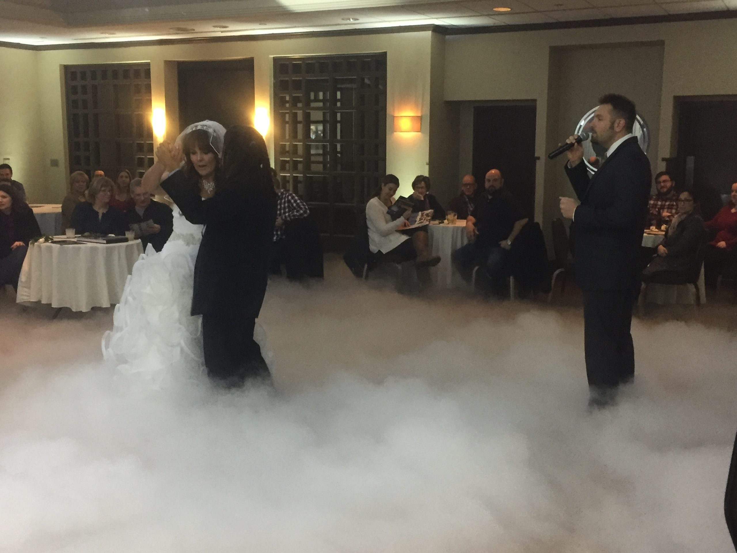Jay Thomson singing the first dance while our bride and groom dance on the clouds