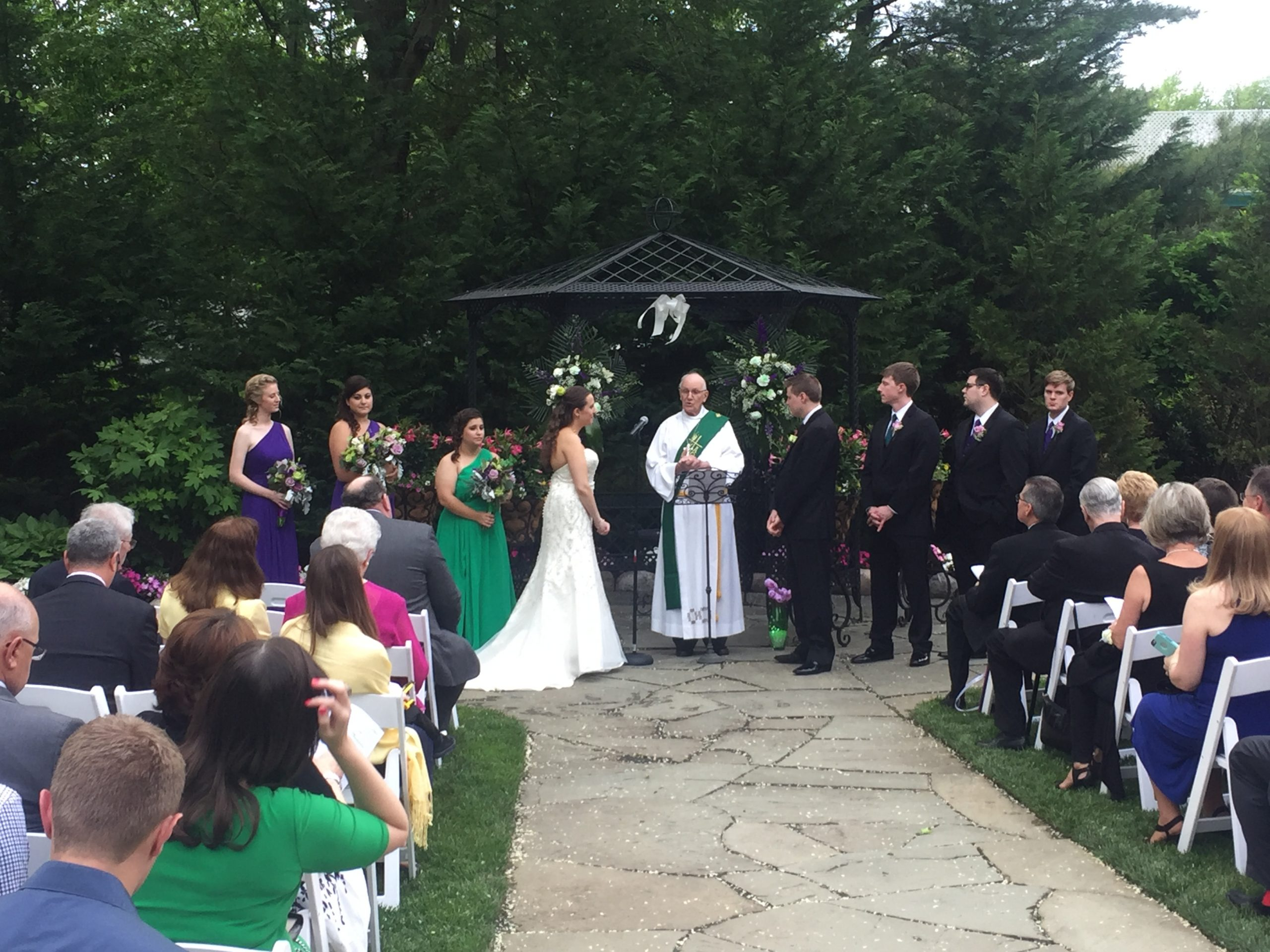 The rains threatened but in the end Evelyn and Sean got married outside!
